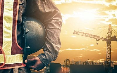 Illustrative image of a builder at a construction site (shih-wei, iStock by Getty Images)