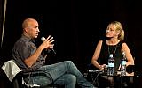 Avi Issacharoff (left), the creator of 'Fauda,' speaks with Sarah Tuttle-Singer at a Times of Israel event on December 3, 2017 in Jerusalem (Beit Avi Chai)