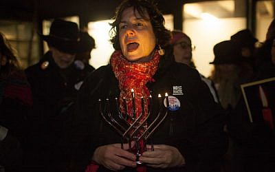 Rabbi Debra Cantor of Congregation B'nai Tikvoh-Sholom in Bloomfield, Conn., speaking at Trump Tower in Manhattan at the 'Not The White House Chanukah Party,' a protest organized by T'ruah, Dec. 13, 2017. (JTA/Jake Ratner)