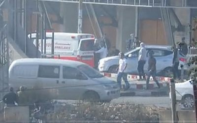 Screen capture from video of a Palestinian Red Crescent ambulance apparently bringing masked protesters to a demonstration in the West Bank, December 11, 2017. (IDF spokesperson)
