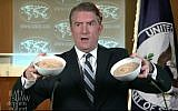 "A ""State Department spokesman"" holds up two bowls of hummus during a sketch poking fun at US President Donald Trump's recognition of Jerusalem as Israel's on ""The Late Show with Stephen Colbert"" aired on December 7, 2017. (Screen capture: YouTube)"