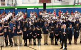 Over 500 students from Ben Porat Yosef in Paramus, New Jersey, broke the world record for the largest human menorah on December 13, 2017. (Screenshot: JTA via NorthJersey.com)