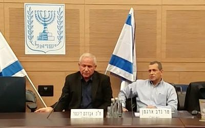 Head of the Shin Bet security service, Nadav Argaman, right, speaks at the Knesset's Foreign Affairs and Defense Committee, which is led by Likud MK Avi Dichter, left, on December 24, 2017. (Screen capture)