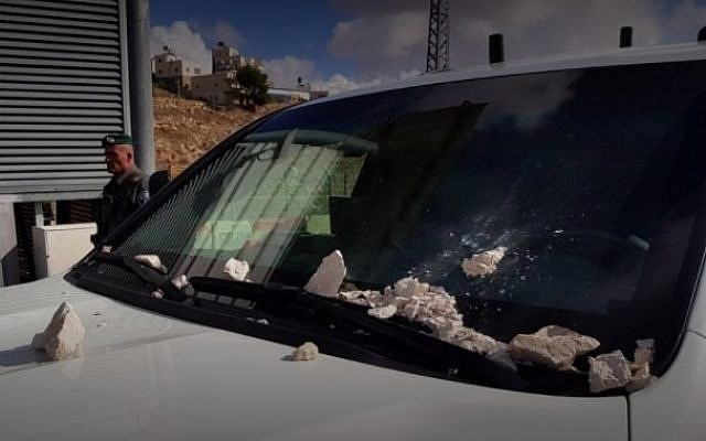 Public Security Minister Gilad Erdan's vehicle, which was stoned in the Palestinian town of Abu Dis on December 25, 2017. (Courtesy)