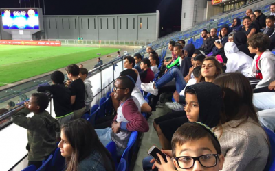 Children from Bet Elazraki Children´s Home and Neve Michael Children's Village at a Hapoel Ra'anana AFC soccer game against Hapoel Tel Aviv FC. (Courtesy, Sharing Seats Israel)