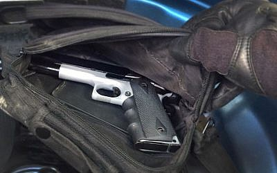 Israeli security forces recover a pistol that was allegedly going to be used to abduct an Israeli in a Hamas kidnapping plot, which was foiled by the Shin Bet security service in October 2017. (Shin Bet)