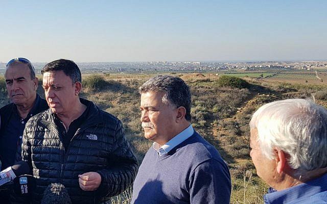 Zionist Union leader Avi Gabbay (2nd L) and former defense minister Amir Peretz (2nd R) tour the Gaza border region on December 26, 2017 (Courtesy/Zionist Union)