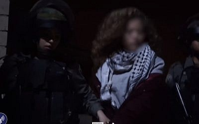 Israeli security forces arrest Ahed Tamimi for hitting soldiers in the West Bank city of Nabi Saleh on December 19, 2017. (screen capture: Israel Defense Forces)