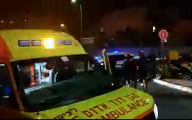 An ambulance in Sderot after a rocket explodes in a street in the city, December 8, 2017 (Channel 10)