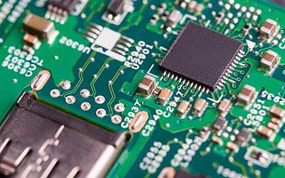 Close up of electronic components on the motherboard, microprocessor chip (Tsyb Oleg, iStock by Getty Images)