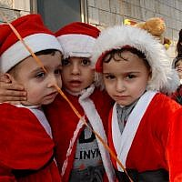 Israeli-Arab children attend a Christmas parade outside the Church of the Annunciation in the northern Arab Israeli city of Nazareth, the place where Christians believe the angel Gabriel told Mary that she would give birth to Jesus Christ. December 24, 2009. (Gili Yaari / FLASH90)