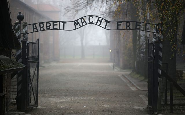 The main gate of the former Auschwitz extermination camp in Oswiecim, Poland, with the infamous sign reading 'Work sets you free.' (Christopher Furlong/Getty Images/via JTA)
