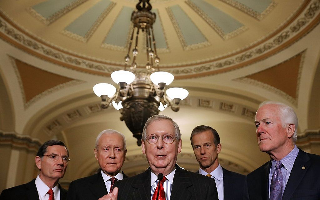 Senate Majority Leader Mitch McConnell speaking as other Republican leaders in the Senate, from left to right, John Barrasso, Orrin Hatch, John Thune and John Cornyn, look on, November 28, 2017. (Chip Somodevilla/Getty Images/via JTA)