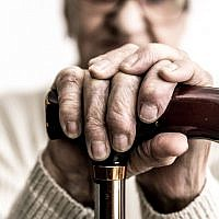 Illustrative image of an elderly person with a cane. (oneinchpunch/ iStock by Getty Images)