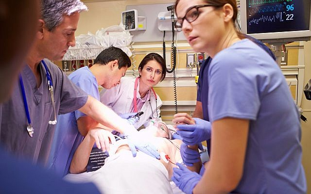 Illustrative image of a medical team working on a patient in the ER (monkeybusinessimages, iStock by Getty Images)