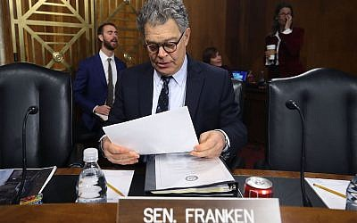 Sen. Al Franken  looks over his papers during a Senate Energy and Natural Resources Committee hearing on hurricane recovery efforts in Puerto Rico and US Virgin Islands, on Capitol Hill November 14, 2017 in Washington, DC.  (Photo by Mark Wilson/Getty Images via JTA)