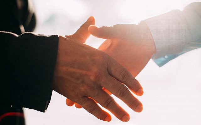 Illustrative image of a handshake (MangoStar Studio, iStock by Getty Images)