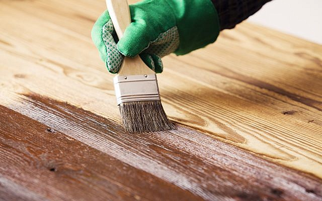 Painting and wood maintenance. A new report on health and the environment recommends research into in-house pollution. (gkrphoto via istockphoto/Getty Images)
