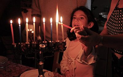 Lighting Hanukkah candles. (Illustrative image via iStock)