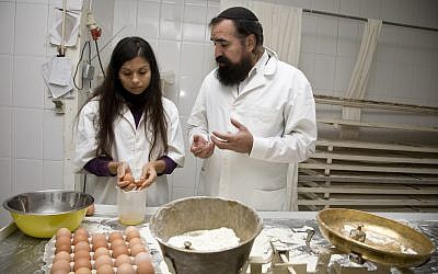 Rabbi Elisha Salas, right, instructing a baker in Belmonte, Portugal, in the preparation of kosher challah, April 2012. (Courtesy of Shavei Israel/via JTA)