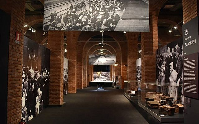 At the Madrid, Spain, installation of a global tour of artifacts from Auschwitz-Birkenau, artifacts from the former Nazi death camp are juxtaposed with some of the victims' belongings (Courtesy of Musealia)