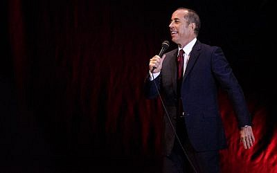 Jerry Seinfeld performing at the Menora Mivtachim Arena in Tel Aviv, Dec. 19, 2015. (Guy Prives/Redferns/Getty Images via JTA)