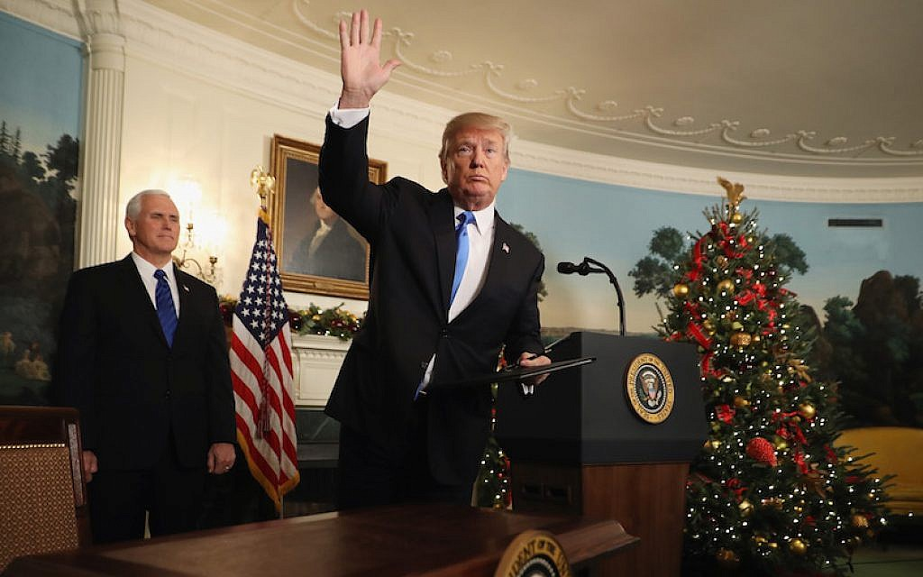 Donald Trump waving to reporters, as Vice President Mike Pence looks on, after announcing that the US government will formally recognize Jerusalem as the capital of Israel in the Diplomatic Reception Room at the White House, Dec. 6, 2017. (Chip Somodevilla/Getty Images via JTA)