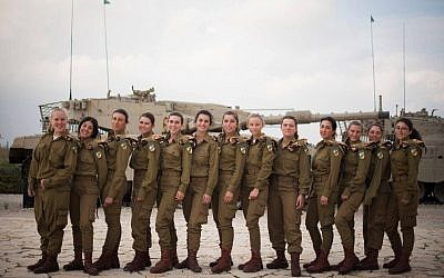 Israel's 13 first female tank operators, who completed their training on December 5, 2017, pose for a photograph at the Armored Corps' monument in Latrun, outside Jerusalem. (Israel Defense Forces)