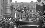 In Weimar, Germany, Adolf Hitler participates in a Nazi party rally, 1930 (public domain)
