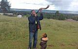 Yehudah Kimani blows a shofar on December 13, 2017, in his home of Kasuku in the highlands of Kenya. (courtesy Yehudah Kimani/Facebook)