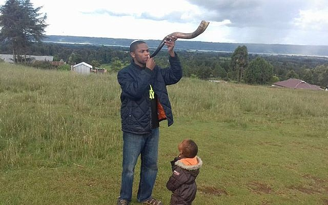 Yehudah Kimani blows a shofar on December 13, 2017, in his home of Kasuku in the highlands of Kenya. (courtesy Yehudah Kimani/Facebook)