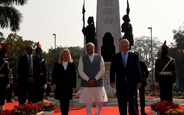 Prime Minister Benjamin Netanyahu, right, together with Indian Prime Minister Narendra Modi, center, and the Israeli leader's wife Sara Netanyahu, left, during the dedication of Haifa Chowk Square, Delhi, India, January 14, 2018. (Avi Ohayon/GPO)