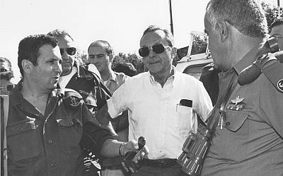 Then-defense minister Moshe Arens, center, meets with then-deputy IDF chief of staff Maj. Gen. Ehud Barak and then-head of the southern command Maj. Gen. Yitzhak Mordechai in 1991. (Ofer Lafler/Israel Defense Forces/Defense Ministry's IDF Archive)