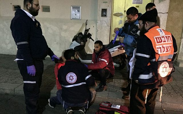 Medics treating a patient on December 31, 2017. (Courtesy/Yissachar Weiss)