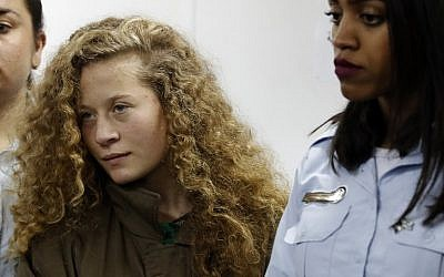 16-year-old Palestinian Ahed Tamimi (C) attends a hearing at the Ofer military court in the West Bank on December 28, 2017. (AFP Photo/Ahmad Gharabli)