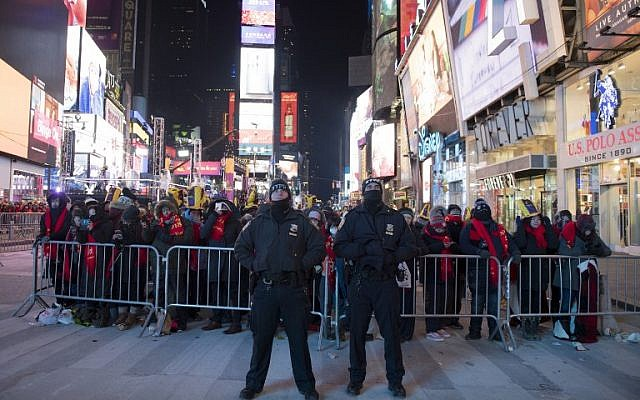NYPD officers stand guard during New Year's Eve in Times Square activities on December 31, 2017 in New York. AFP/Don Emmert)