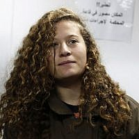 Palestinian teenager Ahed Tamimi, center, attends a hearing at the Ofer military court in the West Bank on January 1, 2018. (AFP Photo/Ahmad Gharabli)