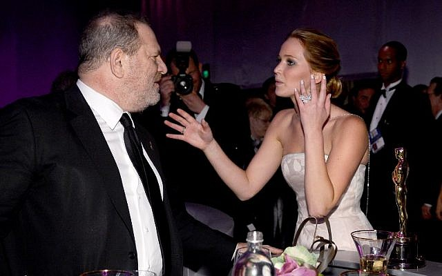 This file photo taken on February 24, 2013 shows actress Jennifer Lawrence, winner of the award for Best Actress for her performance in 'Silver Linings Playbook ' talking to producer Harvey Weinstein as she attends the Oscars Governors Ball at Hollywood & Highland Center in Hollywood, California.    (AFP PHOTO / GETTY IMAGES NORTH AMERICA / KEVORK DJANSEZIAN)