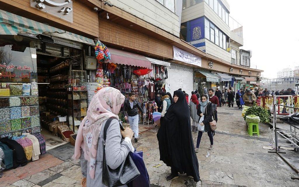 Illustrative: Iranians walk on a street in the capital Tehran on January 2, 2018. (AFP/ ATTA KENARE)