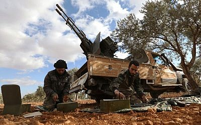 Opposition fighters prepare ammunition in the al-Mushrifa area, near the town of Khan Sheikun in Syria's northwestern rebel-held province of Idlib, during ongoing clashes with government forces, on January 2, 2018.  (OMAR HAJ KADOUR/AFP)