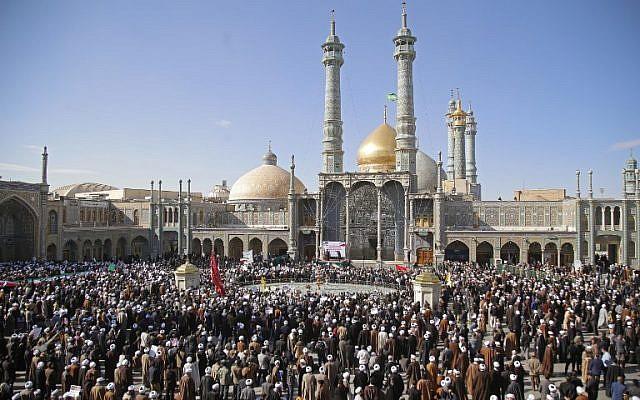 Illustrative: Pro-government demonstrators gather at the Massoumeh shrine in Iran's holy city of Qom on January 3, 2018. (AFP PHOTO / Mohammad ALI MARIZAD)