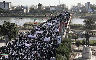 Pro-government demonstrators march in Iran's southwestern city of Ahvaz on January 3, 2018. (TASNIM NEWS/MORTEZA JABERIAN/AFP)