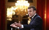 French President Emmanuel Macron delivers New Year wishes to the press at the Elysee Palace in Paris, on January 3, 2018.(AFP PHOTO / POOL / LUDOVIC MARIN)
