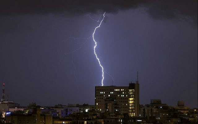 Lightning is seen above the coastal city of Netanya on January 4, 2018, as the worst storm of the winter hits Israel. (AFP Photo/Jack Guez)