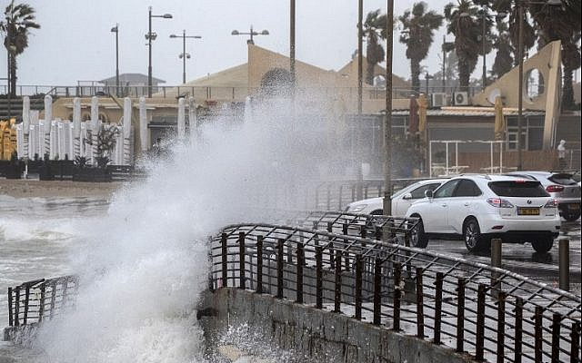 Waves crash on the seafront of the coastal city of Netanya on January 5, 2018, as the worst storm of the winer hits Israel. (AFP Photo/Jack Guez)