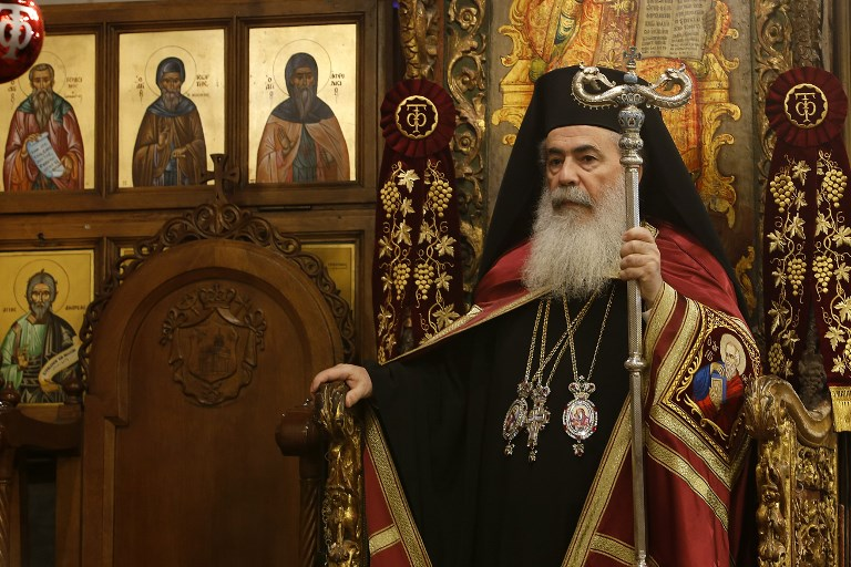 jerusalems greek orthodox patriarch theophilos iii leads the christmas midnight mass for the greek orthodox at