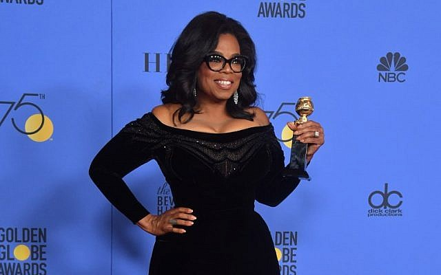 Actress and TV talk show host Oprah Winfrey poses with the Cecil B. DeMille Award during the 75th Golden Globe Awards on January 7, 2018, in Beverly Hills, California. (AFP PHOTO / Frederic J. BROWN)