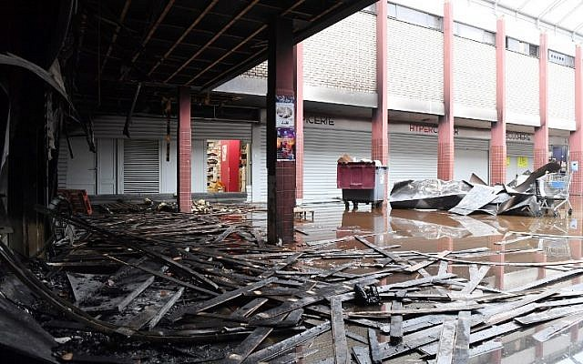 A partial view taken of the Promo & Destock store, a French kosher grocery store in Creteil, south of Paris, after it was destroyed in an arson attack on January 9, 2018 . (AFP Photo/Alain Jocard)