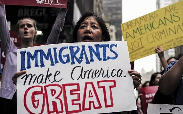 This file photo taken on October 05, 2017 shows protesters during a demonstration against US President Donald Trump during a rally in support of the Deferred Action for Childhood Arrivals (DACA), also known as Dream Act, near the Trump Tower in New York. (AFP PHOTO / Jewel SAMAD)