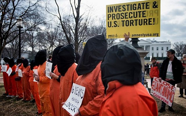 Activists protest the Guantanamo Bay detention camp during a rally in Lafayette Square outside the White House January 11, 2018 in Washington, DC. (AFP/Brendan Smialowski)